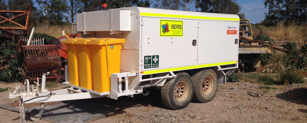 A spill response trailer on site of hazardous material spill