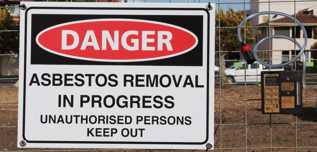 Sign at worksite reading Asbestos Removal in Progress